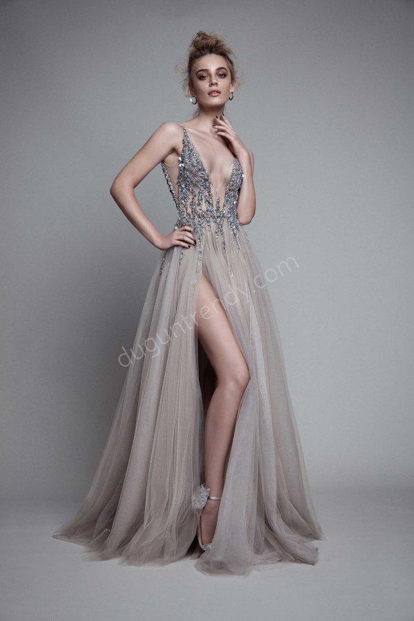 taş işlemeli yırtmaçlı  elbise modeli